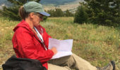 OU alum Lorraine Manz, of the North Dakota Geological Survey, reviews her map high in the Beartooth Mountains of Montana.  Lorraine attended field camp with OU Field Camp Director Keith Milam in this very same area 21 years ago this past summer.