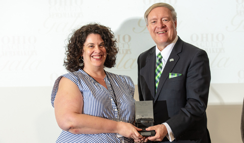 Dr. Sara Poggione and President M. Duane Nellis at the OHIO Newsmakers Gala, holding the keystroke award.