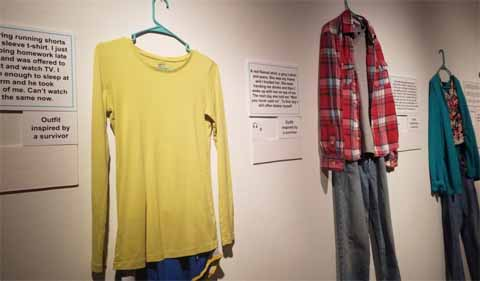 Clothing worn by survivors in What were you wearing? exhibit. Shown her: long-sleeved yellow shirt and running shorts, flannel shirt and jeans....