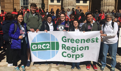 Jordan Francisco (second from right) with fellow members of the Greenest Region Corps., shown here holding a GRC banner.