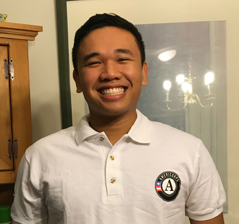 Jordan Francisco proudly wears his Americorps shirt.
