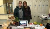 Food Studies students Joy Jostansek and Rachel McDonald pose for a photo at the Food Studies table during the Meet Your Farmers Market.