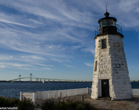 Site of North American Vascular Biology Organization in Newport, RI, with lighthouse in foreground and bridge in background.