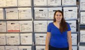 Rachel Meyer at the Geier Collections and Research Center, standing in front of the collection from the Hahn's Field Site excavations
