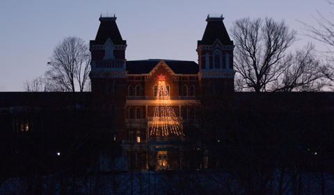 The Ridges at night, silhouetted with holiday lights.