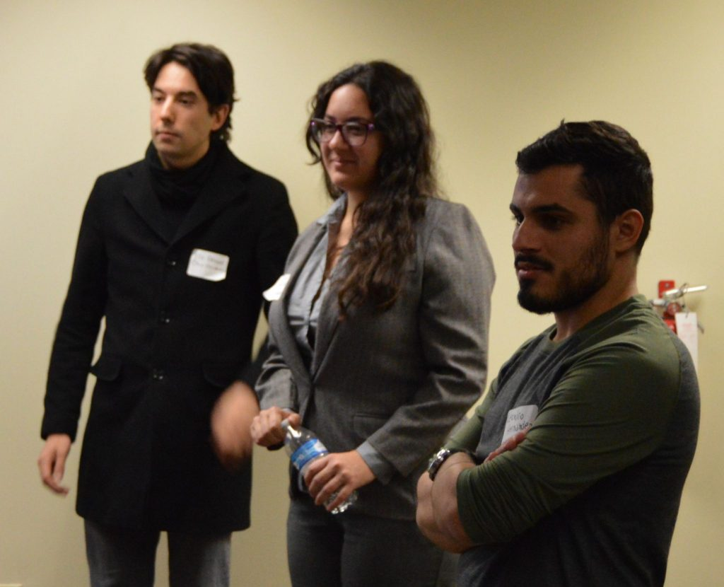 Grad student speakers Carla Consolini, Leandro Hernandez and Florent Réthoré stand together before giving a presentation.