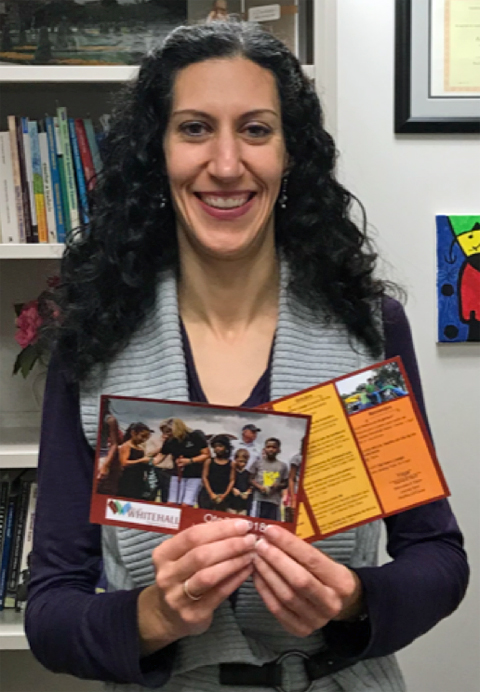 Dr. María Postigo, holding documents she translated from English into Spanish to be shared at the Latino Night in Whitehall, Ohio.