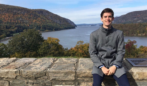 Max Annable at West Point Academy, overlooking a river in the background