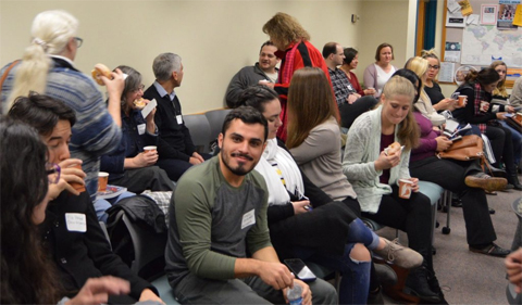 Ohio Valley Foreign Language Alliance--photo of grad students sitting in a group at the event.
