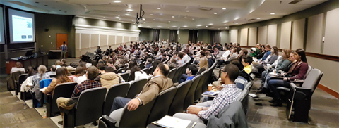 Bowling Green State University graduate student Jayan Karunarathna (Dr. Alexis Ostrowski's research group) presents his research to a near capacity room in 135 Walter Hall.