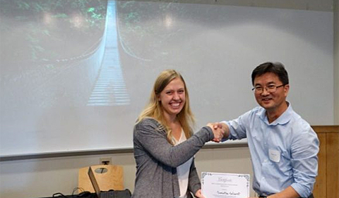 HTC Neuroscience student Samantha Selhorst with Neuroscience Program Director Dr. Daewoo Lee at Neuroscience Research Day