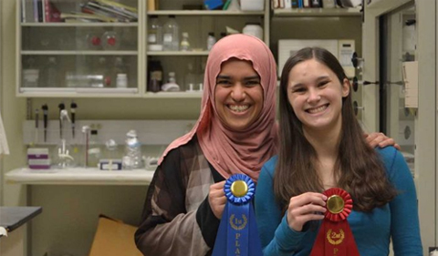 From left, Sazan Ismael and Marissa Smarelli display prizes for their research at Neuroscience Research Day.