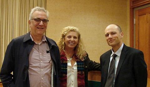 Group photo of E.W. Scripps School of Journalism Director Dr. Robert Stewart, Meg Prior, and CHI Director Dr. Ingo Trauschweizer