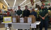 Nicholas Snider, Steven Weinstein, Kyle Bussard, and Peter Hein at the Kroger donation station.