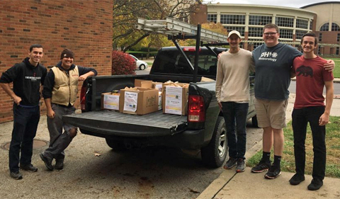 Doug Schmaltz and his Good Works colleague in the left side of the truck; Colin Hesler (GIS major), Matthew Thigpen (OUCAMS President), and Steven Weinstein