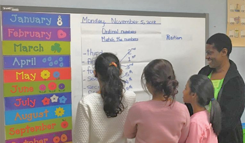 Vanessa Torrington working with students at East Elementary, shown here at white board.