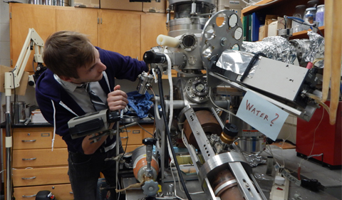 Physics doctoral student Michael Mroz uses a low-energy electron microscope to examine the physical properties of compounds that make up thermionic cathodes.