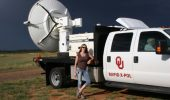 Dr. Jana Houser with University of Oklahoma's Rapid-scan, X-band, polarimetric mobile radar (RaXPol).