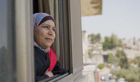 Kholoud al-Faqih, portrait, looking out window