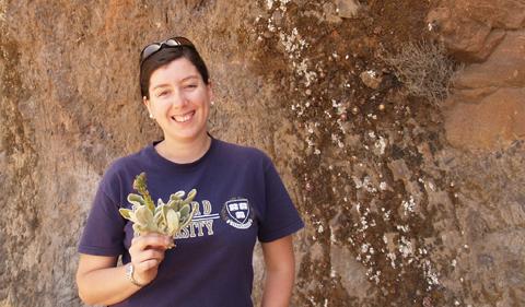 Dr. Pamela Puppo, portrait holding plant