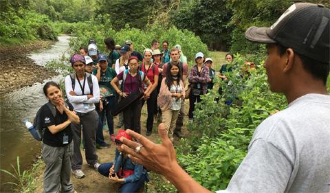 Ecuador Tropical Disease summer program participants listening to a speaker