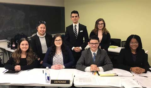 Group shot of Mock Trial team prior to competition at Xavier