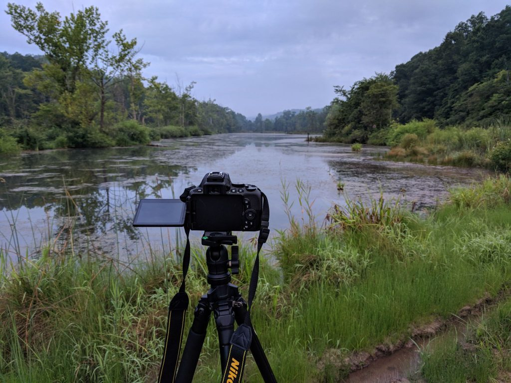 Camera in front of lake