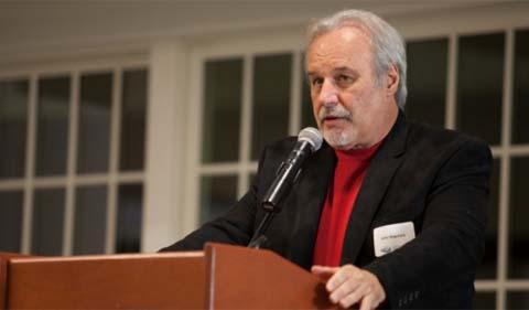 Dr. John J. Kopchick, standing at lecturn