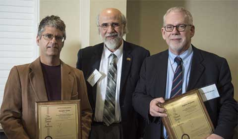 Executive Vice President and Provost Chaden Djalali (middle) awards Douglas Goetz (left) and Stephen Bergmeier (right) with U.S. patent plaques.
