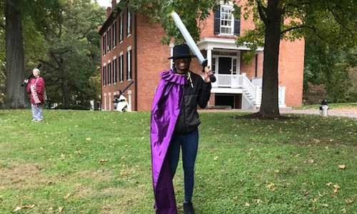 Holding a fake sword, DJ Wilkins, a junior Strategic Communications major, get ready to LARP.