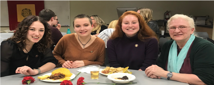 From left to right: New Sigma Delta Pi initiates Kaitlyn Booher, Carolyn Summerford, and Rory O'Malley with Spanish Professor Dr. Betsy Partyka.