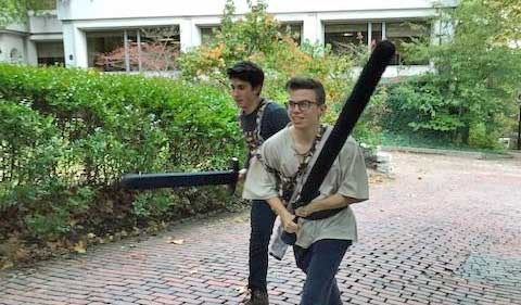 From left, Grant Crawford and Alex Petras get ready for Live Action Role Playing, fake weapons held aloft.