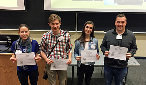 From left, award winners Anne Sternberger, Calvin Coffin, Abigail Moore,