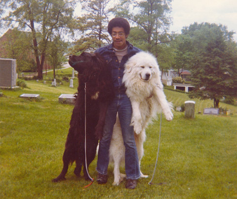 """Captain Fuller and his two dogs in Athens, Ohio, 1973. """"While I was an OHIO graduate student in the early '70s, the unpopular war in Vietnam was still raging, and it was more advantageous to set aside the military uniform and dress local, including growing long hair!"""""""
