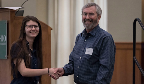 Dr. Greg Nadon presents the Maurice and Betty Warner scholarship to Abigail Gentry