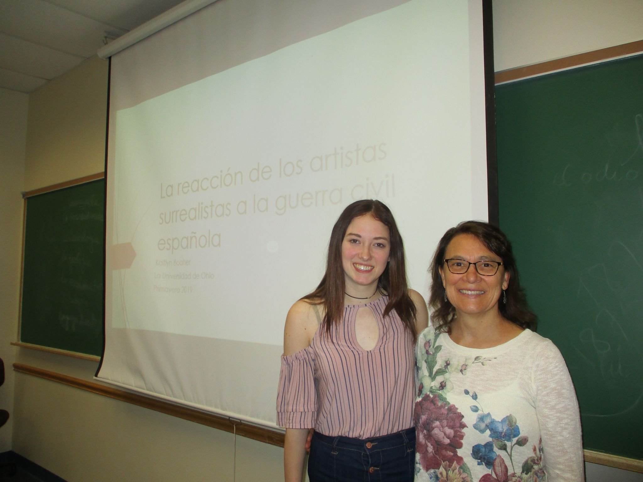 """Honors Tutorial College Spanish Major, freshman Kaitlyn Booher (left), poses with Associate Professor of Spanish, Dr. Mary Jane Kelley (right), prior to giving her presentation """"The Reaction of Surrealist Artists to the Spanish Civil War."""""""