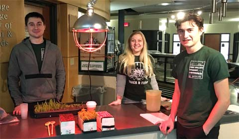 Renaissance Engineers John Corcella, Rachel Modzelewski and Johnny Murray prepare for a day of teaching students about green rooftops at the Annual Engineering and Technology Day at Russ College.