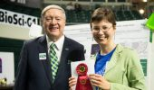 Kira Slepchenk with President M. Duane Nellis.