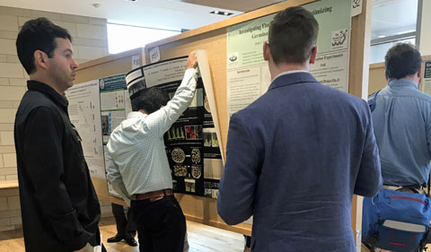 Students display their poster presentations at ASPB Midwest regional