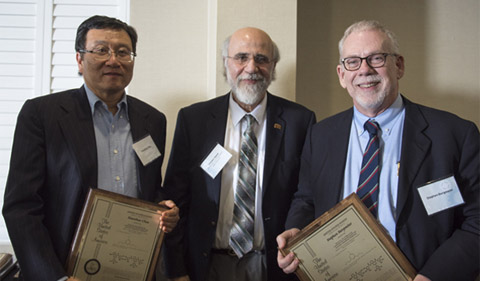 Dr. Xiaozhuo Chen (left) and Stephen Bergmeier (right) are presented awards by Dr. Chaden Djalali,(center) Executive Vice President and Provost.