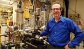 Arthur R. Smith poses in front of his group's spin- polarized scanning tunneling microscope.