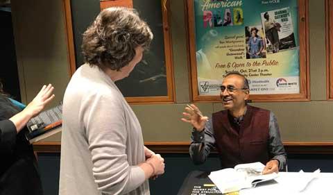 Dr. Venki Ramakrishnan enjoys signing books.