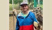 Naturalist Adam Hunt with Earl, the Great Horned Owl