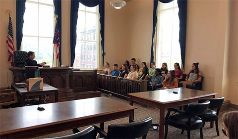 Judge Patrick Lang meets students in his courtroom