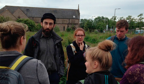 Dr. Hamish Kallin, University of Edinburgh, discussing the history of Craigmillar with students enrolled in the Edinburgh: City and Environment program (Photo by G.L. Buckley, June