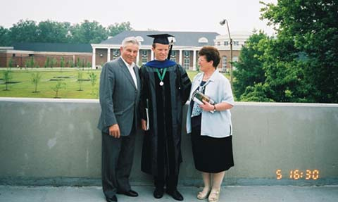 Andreas Weichselbaum with his parents at graduation