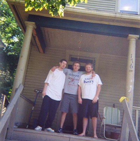 Dorans in his college days, with buddies on house steps.