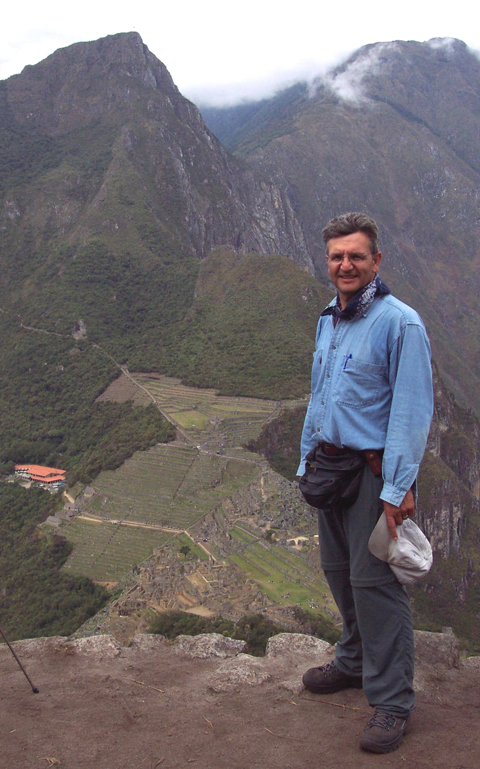 Eric Bikis mapping ancient sites atop Huayna Picchu in Peru in 2003.