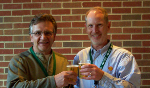 Eric Bikis and Geological Sciences Alumni Board Chairman Pat Jackson toast to a successful symposium in 2012.