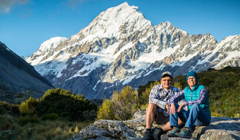 Eric and Linda Bikis in New Zealand, with snow-capped mountains in the background
